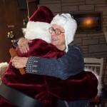 Santa hugging an elderly woman
